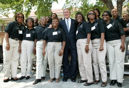 President George W. Bush poses for a photograph with the 16th Street Baptist Church Choir of Birmingham, Ala., at the Brown V. Board of Education National Historic Site in Topeka, Kan., Monday, May 17, 2004. White House photo by Eric Draper.