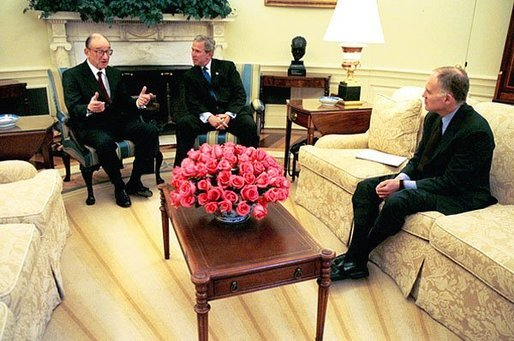 President George W. Bush talks with Federal Reserve Board Chairman Alan Greenspan in the Oval Office Tuesday, May 18, 2004. President Bush sent the U.S. Senate his nomination to reappoint Mr. Greenspan as the Federal Reserve Board Chairman Tuesday afternoon. Also pictured is National Economic Council Director Stephen Friedman, right. White House photo by Joyce Naltchayan