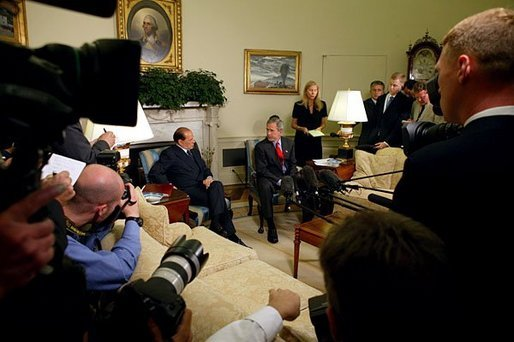 President George W. Bush and Prime Minister Silvio Berlusconi of Italy make a joint statement to the press in the Oval Office Wednesday, May 19, 2004. The two leaders discussed the development of a strategy for the full transfer of sovereignty to an interim Iraqi government June 30. White House photo by Joyce Naltchayan.