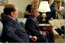 President George W. Bush and Prime Minister Silvio Berlusconi of Italy address the media in the Oval Office Wednesday, May 19, 2004.  White House photo by Joyce Naltchayan