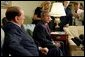 President George W. Bush and Prime Minister Silvio Berlusconi of Italy address the media in the Oval Office Wednesday, May 19, 2004. White House photo by Joyce Naltchayan.
