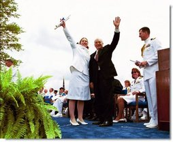 Following his commencement address to the U.S. Coast Guard Academy, Vice President Dick Cheney and Cadet Jen Frye, 22, of New Market, Va., wave to her friends and family after he presented the graduating cadet her commission in New London, Conn., Wednesday, May 19, 2004.  White House photo by David Bohrer