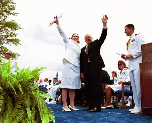 Following his commencement address to the U.S. Coast Guard Academy, Vice President Dick Cheney and Cadet Jen Frye, 22, of New Market, Va., wave to her friends and family after he presented the graduating cadet her commission in New London, Conn., Wednesday, May 19, 2004. White House photo by David Bohrer.