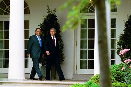 After meeting in the Oval Office, President George W. Bush and Prime Minister Konstandinos Karamanlis of Greece visit the Rose Garden Thursday, May 20, 2004. White House photo by Joyce Naltchayan