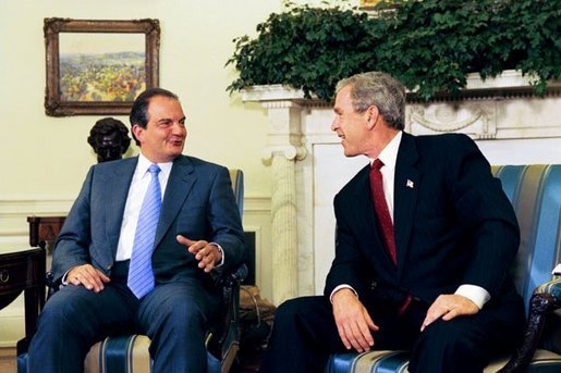 President George W. Bush meets with Prime Minister Konstandinos Karamanlis of Greece in the Oval Office Thursday, May 20, 2004. White House photo by Joyce Naltchayan