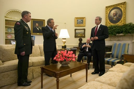President George W. Bush and Vice President Dick Cheney meet with Secretary of Defense Donald Rumsfeld and General John Abizaid, Combatant Commander of the U.S. Central Command, in the Oval Office Thursday, May 20, 2004. White House photo by Eric Draper