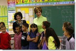 "Laura Bush visits with students from Ms. Valdez's first grade reading class at Reginald Chavez Elementary School in Albuquerque, N.M., Thursday, May 20, 2004. In her remarks, Mrs. Bush discussed the Summer Reader's Achievement Program, ""And the goal of it is to encourage children in kindergarten through eighth grade to read over the summer, which will mitigate the loss in reading skills that research shows takes place in students, especially low-income students who leave school in the spring and don't pick up a book all summer and then come back in the fall and they really have to start over again on a lot of their reading skills.""  White House photo by Tina Hager"
