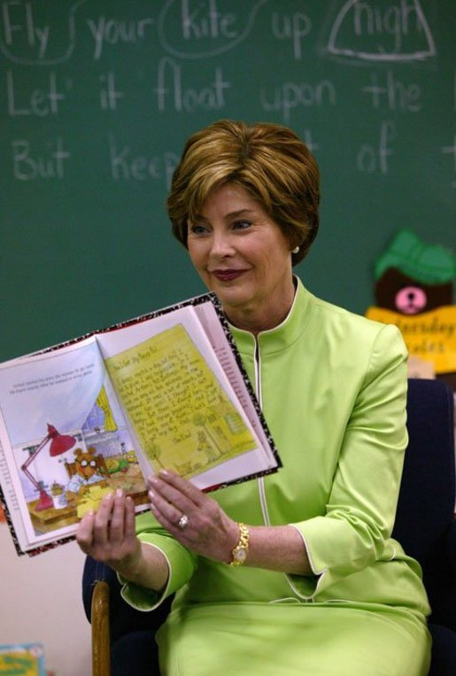 Laura Bush reads Arthur Writes a Story by Marc Brown to Ms. Valdez's first grade reading class at Reginald Chavez Elemantary School in Albuquerque, N.M., Thursday, May 20, 2004. During her visit, Mrs. Bush encouraged children to keep reading throughout the summer. White House photo by Tina Hager