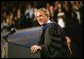 "President George W. Bush imparts some light-hearted audience to the graduating students at the Louisiana State University Commencement in Baton Rouge, La., Friday, May 21, 2004. ""As you enter professional life, I have a few other suggestions about how to succeed on the job. For starters, be on time. It's polite, and it shows your respect for others. Of course, it's easy for me to say,"" said the President. ""It's easy for me to be punctual when armed men stop all the traffic in town for you."" White House photo by Eric Draper."