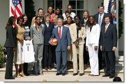 President George W. Bush takes a team photo with the Detroit Shock, the 2003 WNBA champions in the Rose Garden on May 24, 2004.  White House photo by Paul Morse