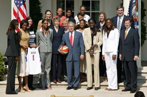 President George W. Bush takes a team photo with the Detroit Shock, the 2003 WNBA champions in the Rose Garden on May 24, 2004. White House photo by Paul Morse.