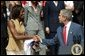 President George W. Bush greets Detroit Shock player Swin Cash during a photo opportunity with the 2003 WNBA champions in the Rose Garden on May 24, 2004. White House photo by Paul Morse.