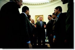 "President George W. Bush talks with several Iraqis who receive medical care in the United States during a meeting in the Oval Office Tuesday, May 25, 2004. The Iraqi citizens each had one hand cut off in Iraq during Saddam's rule. ""They are examples of the brutality of the tyrant,"" said President Bush. ""These men had hands restored because of the generosity and love of an American citizen. And I am so proud to welcome them to the Oval Office.""  White House photo by Eric Draper"