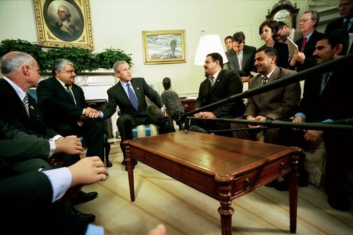 "President George W. Bush talks with the press during an Oval Office meeting with several Iraqis who receive medical care in the United States Tuesday, May 25, 2004. ""I'm honored to shake the hand of a brave Iraqi citizen who had his hand cut off by Saddam Hussein,"" said the President. ""I'm with six other Iraqi citizens, as well, who suffered the same fate. They are examples of the brutality of the tyrant."" White House photo by Eric Draper"