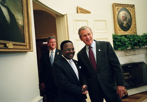 President George W. Bush welcomes President Omar Bongo Ondimba of Gabon to the Oval Office Wednesday, May 26, 2004. White House photo by Eric Draper.