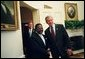 President George W. Bush welcomes President Omar Bongo Ondimba of Gabon to the Oval Office Wednesday, May 26, 2004.  White House photo by Eric Draper