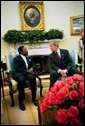 President George W. Bush and President Omar Bongo Ondimba of Gabon meet in the Oval Office Wednesday, May 26, 2004. White House photo by Eric Draper.