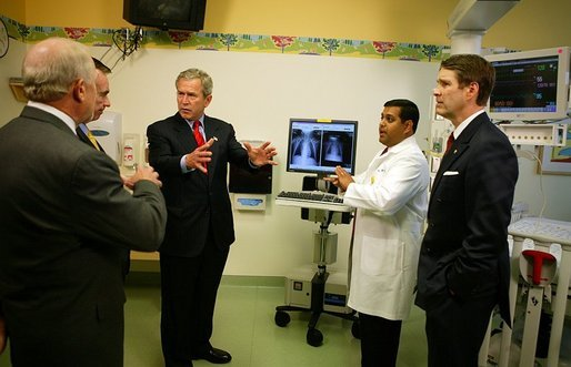 President George W. Bush listens to a demonstration by Dr. Neal Patel on the benefits of using information technology in hospitals at Vanderbilt Children's Hospital in Nashville, Tenn., May 27, 2004. White House photo by Paul Morse