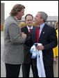 President George W. Bush greets Jason Matthews of the Tennessee Titans NFL team after arriving in Nashville, Tenn., May 27, 2004. White House photo by Paul Morse