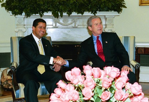 President George W. Bush meets with President Francisco Flores Perez of El Salvador in the Oval Office Thursday, May 27, 2004. White House photo by Joyce Naltchayan