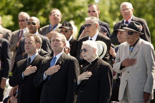 President George W. Bush sings the National Anthem with World War II veterans during the dedication of at the National World War II memorial on the Mall in Washington, DC on May 30, 2004. White House photo by Paul Morse