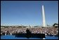 President George W. Bush delivers remarks to thousands of veterans at the National World War II Memorial on the National Mall, Saturday, May 29, 2004. White House photo by Eric Draper