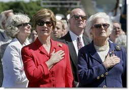 Laura Bush and Former First Lady Barbara Bush stand during the National Anthem at the National World War II Memorial on the National Mall, Saturday, May 29, 2004. White House photo by Eric Draper