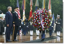 President George W. Bush stands at attention during Wreath Laying ceremonies in commemoration of Memorial Day at Arlington National Cemetery in Arlington, Virginia Monday May 31, 2004.  White House photo by Joyce Naltchayan