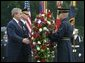 President George W. Bush stands at attention during Wreath Laying ceremonies in commemoration of Memorial Day at Arlington National Cemetery in Arlington, Virginia Monday May 31, 2004. White House photo by Joyce Naltchayan.