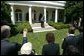 After welcoming the new members of Iraq's interim government, President George W. Bush answers questions from the press in the Rose Garden Tuesday, June 1, 2004. White House photo by Eric Draper.