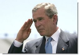President George W. Bush salutes a graduating cadet at the United States Air Force Academy Graduation Ceremony in Colorado Springs, Colorado, June 2, 2004.  White House photo by Eric Draper