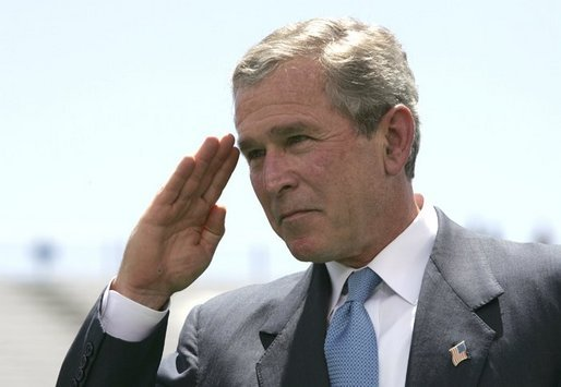 President George W. Bush salutes a graduating cadet at the United States Air Force Academy Graduation Ceremony in Colorado Springs, Colorado, June 2, 2004. White House photo by Eric Draper.