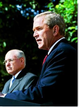 President George W. Bush participates in a joint media availability with Prime Minister of Australia John Howard in the Rose Garden Thursday, June 3, 2004.  White House photo by Joyce Naltchayan