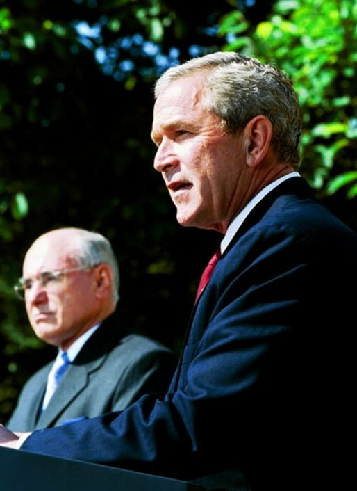 President George W. Bush participates in a joint media availability with Prime Minister of Australia John Howard in the Rose Garden Thursday, June 3, 2004. White House photo by Joyce Naltchayan.