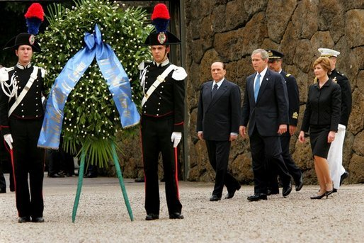 President George W. Bush with Mrs. Bush and Prime Minister of Italy Silvio Berlusconi participate in a wreath laying ceremony at Fosse Ardeatine in Rome, Italy, Friday, June 4, 2004. White House photo by Paul Morse