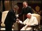 President George W. Bush presents Pope John Paul II with the Medal of Freedom at the Vatican, Friday, June 4, 2004. White House photo by Tina Hager