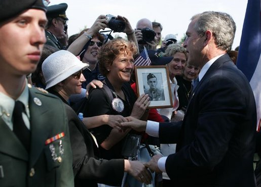 President George W. Bush meets with veterans and their families after delivering remarks during ceremonies marking the 60th anniversary of D-Day at the American Cemetery in Normandy, France, June 6, 2004. White House photo by Paul Morse.