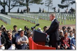 President George W. Bush addresses World War II veterans and families during the 60th anniversary of D-Day at the American Cemetery in Normandy, France, June 6, 2004.  White House photo by Paul Morse