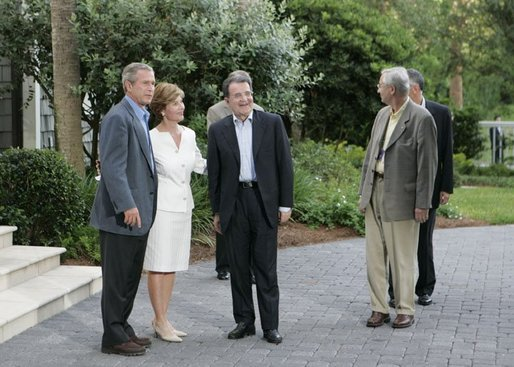 President George W. Bush and Laura Bush greet European Commission President Romano Prodi on his arrival to the G8 Summit on Sea Island, Ga., Tuesday, June 8, 2004. White House photo by Tina Hager
