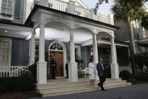 President George W. Bush and Laura Bush await the arrival of leaders attending a social dinner at the G8 Summit on Sea Island, Ga., Tuesday, June 8, 2004. White House photo by Tina Hager