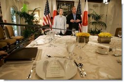 President George W. Bush and Japanese Prime Minister Junichiro Koizumi poses for photographs with during their working lunch at the G-8 Summit on Sea Island, Ga., Tuesday, June 8, 2004.  White House photo by Eric Draper