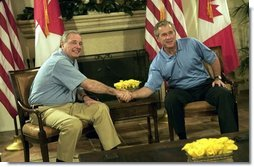 President George W. Bush and Canadian Prime Minister Paul Martin shake hands during their bilateral talks at the G-8 Summit in Sea Island, Ga., Tuesday, June 8, 2004.  White House photo by Eric Draper