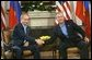 President George W. Bush shakes hands with Russian President Vladimir Putin during their bilateral meeting at the G-8 Summit in Sea Island, Ga., Tuesday, June 8, 2004. White House photo by Eric Draper
