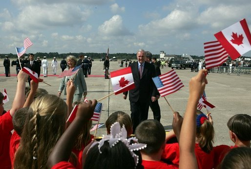 Arriving for the G8 summit at Sea Island, Ga., Canadian Prime Minister Paul Martin walks to greet an enthusiastic crowd at Hunter Air Force Base Tuesday, June 8, 2004. White House photo by Paul Morse