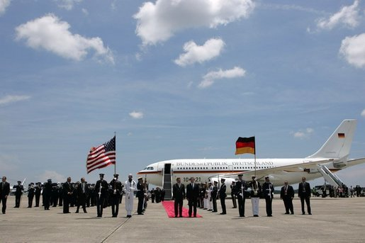 German Chancellor Gerhard Schroeder, left, and Deputy U.S. Chief of Protocol Jeff Eubank participate in an arrival ceremony at Hunter Army Airfield in Savannah, Ga., June 8, 2004. White House photo by Paul Morse