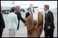 Deputy U.S. Chief of Protocol Jeff Eubank hosts President Ghazi al-Yawer of Iraq's interim government during the arrival ceremony at Hunter Army Airfield in Savannah, Ga., Tuesday, June 8, 2004. The newly elected president will participate in this week's G8 Summit. White House photo by Paul Morse