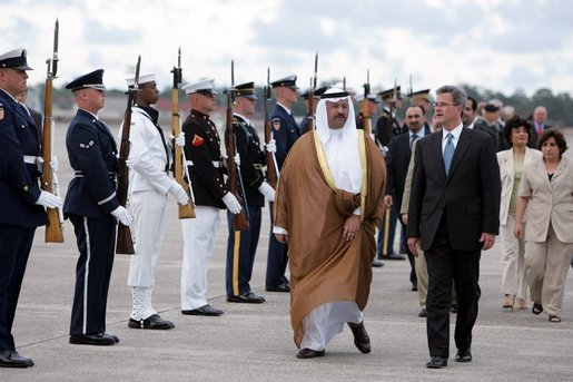 eputy U.S. Chief of Protocol Jeff Eubank hosts President Ghazi al-Yawer of Iraq's interim government during the arrival ceremony at Hunter Army Airfield in Savannah, Ga., Tuesday, June 8, 2004. The newly elected president will participate in this week's G8 Summit. White House photo by Paul Morse