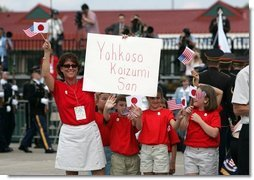 Children cheer the arrival of Japanese Prime Minister Junichiro Koizumi at Hunter Army Airfield in Savannah, Ga., June 8, 2004.  White House photo by Paul Morse