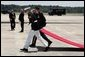 The red carpet is laid out for the arrival ceremonies of the leaders of the G8 member nations at Hunter Army Airfield in Savannah, Ga., Tuesday, June 8, 2004. White House photo by Paul Morse