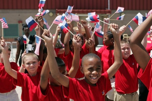School children cheer during the arrival of Russian President Vladimir Putin at Hunter Army Airfield in Savannah, Ga., Tuesday, June 8, 2004. White House photo by Paul Morse